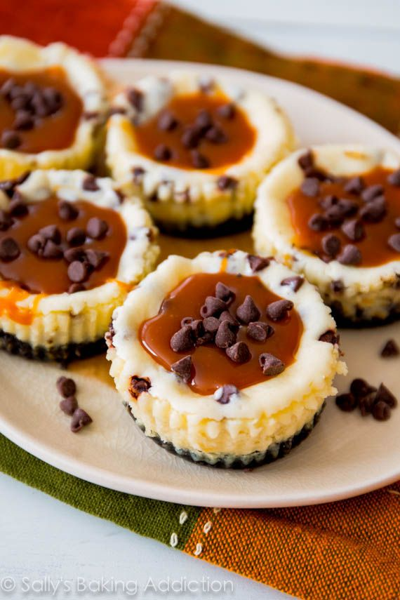 Mini chocolate chip cheesecakes with an Oreo cookie crust and homemade salted caramel. sallysbakingaddiction.com