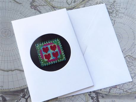 A small handmade card: 3 1/2 by 5 1/2 inches (just under 9 cm x 14 cm).  Green beads surround the outside of the square.