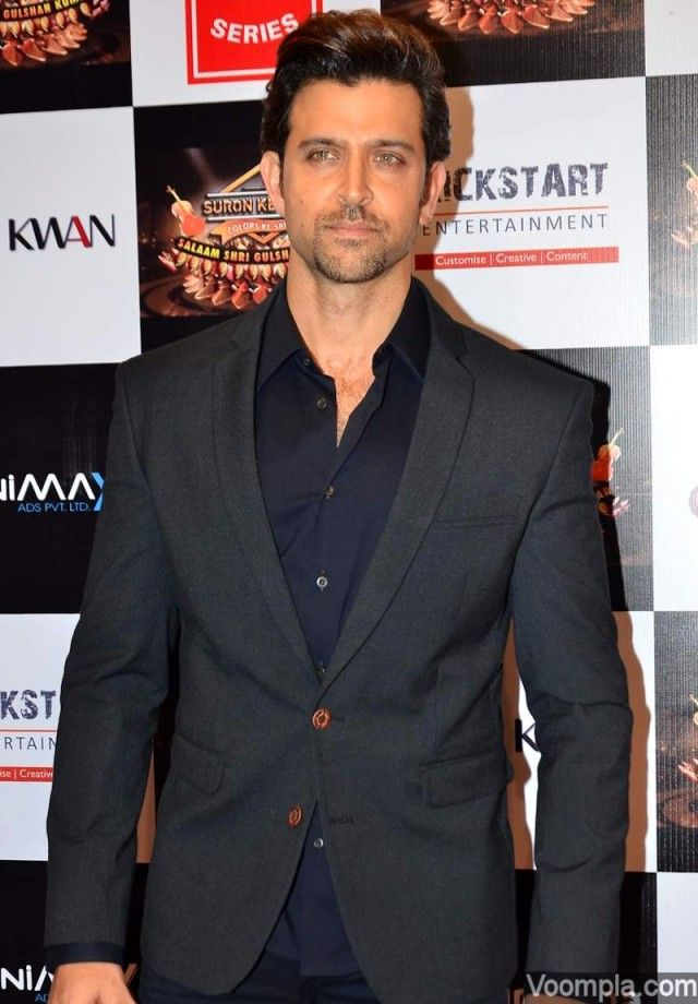 Bollywood hunk Hrithik Roshan looking dapper in a black suit. via Voompla.com