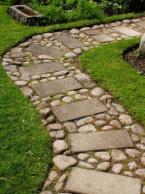 Inexpensive path. Apparently if you sprinkle baking soda on the dirt twice a year, nothing will grow there. @ DIY Home Ideas