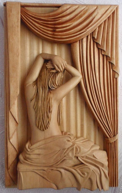 woman in bed - relief wood carving