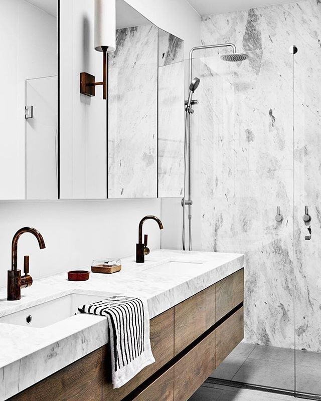 A striking contemporary bathroom ~ marble & burnished brass fixtures & floating timber vanity ~ by @wearehuntly