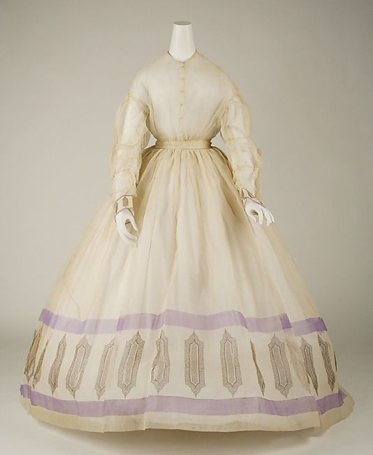 c. [1860-1865] dress, American or European. Cotton. The Met, 1992.31.6. [Originally dated c. 1850, but the sleeves and the shape of the skirt are clearly 10 years later.]