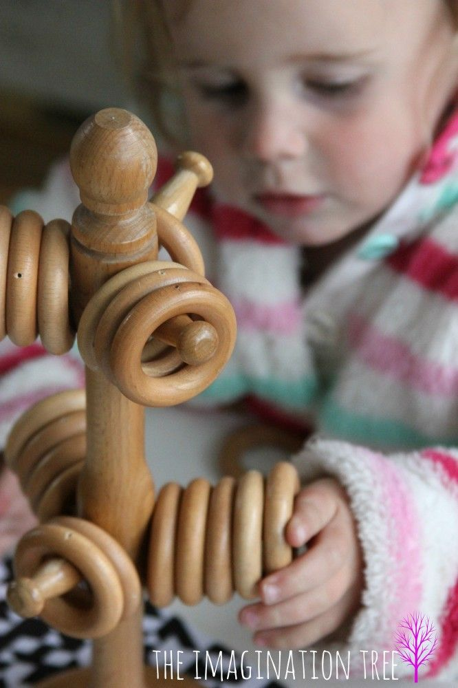 Wooden rings on a mug tree make a great learning toy for babies and toddlers!