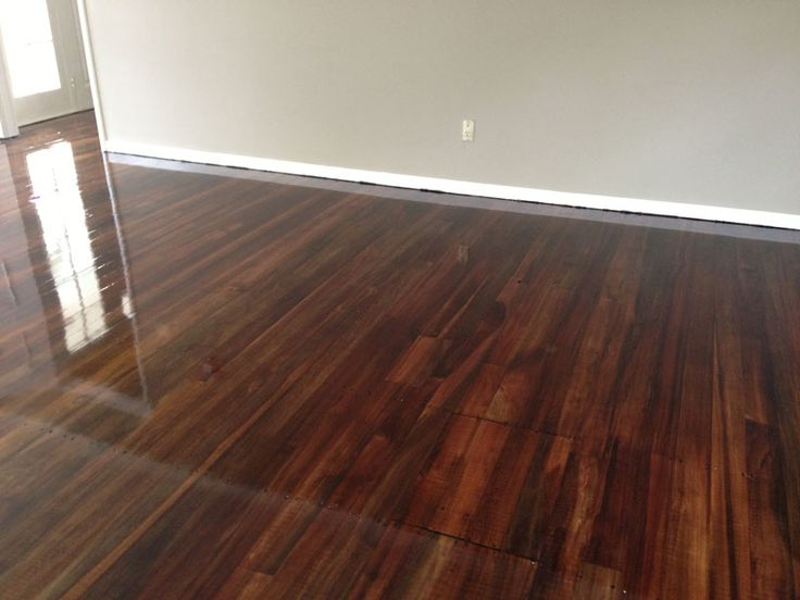 Mid brown and dark walnut mixture applied to a coloured matai T&G floor.