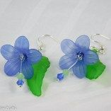 Blue lucite flower bead earrings with green leaf are a long length, shoulder duster style of earring featuring blue lucite flowers and green leaves