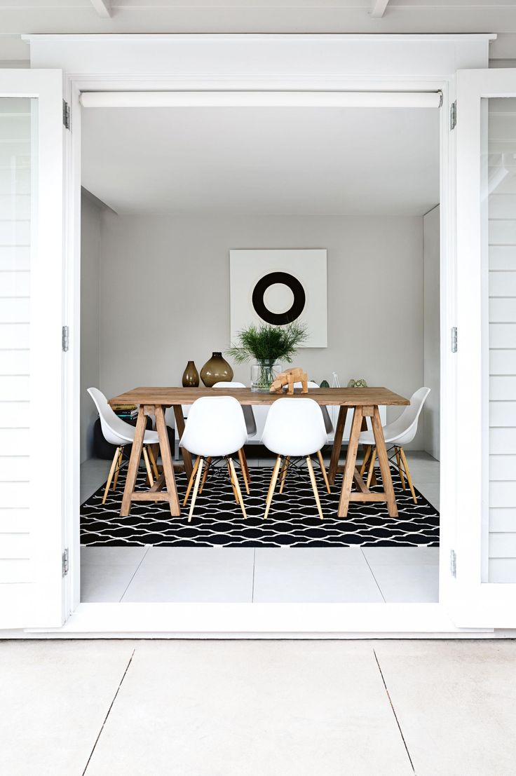 Natural wood table with black and white accents.