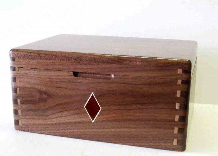<p>Walnut and maple jewrely box.  Semi gloss lacqure finish.  Small bloodwood and holly inlay.  Tray for jewrely box is also maple and walnut.  Put together with exposed boxjoint for an accent.  Idea for the joints was from a WWS employees previous post</p>