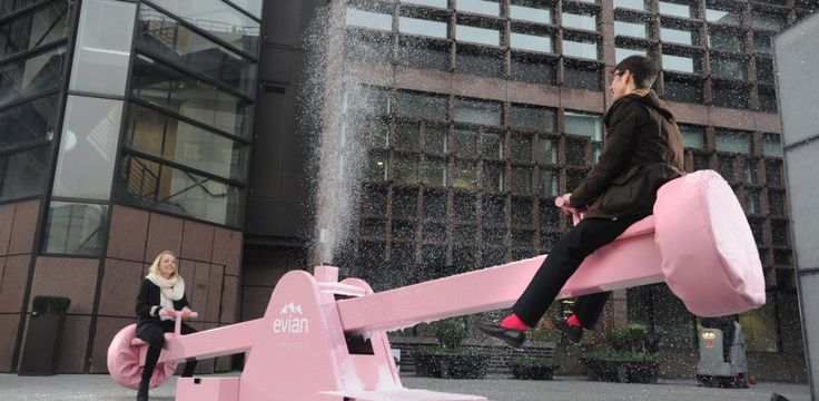 """Experiential Event – Interactive swing and see-saw – Canary Wharf & Finsbury Avenue Square, London  Londoners bounced back after the Christmas break & swung into the new year, when we installed our giant snow-producing playground installations in two of the capital's commuter hotspots. These adult-sized """"Live Young Swings"""" in Canary Wharf and a giant"""