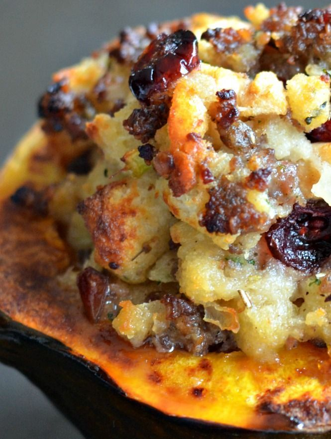 The MOST PINNED, most VIEWED, most PRINTED recipe on the blog!!   Acorn squash is roasted and topped with a homemade stuffing with sausage, apples and cranberries.  See our review on People.com !