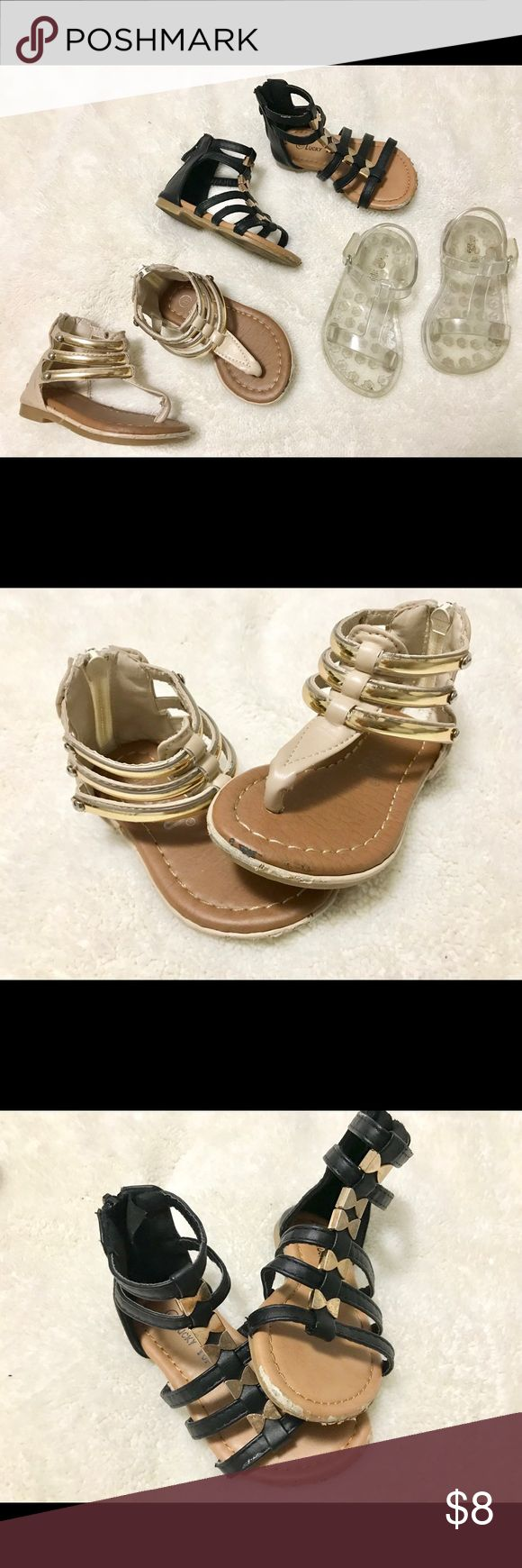 Bulk Gap, Jumbo Coco & Lucky Top Gladiator Sandals Selling all together used Sandals Pictures provided to show condition but very much still has life left!  Gap clear Sandals with Velcro closure Size 5 Condition: great condition   Jumbo Coco Black Gladiators  with back zipper closure  Size 5 Condition: Used  Lucky Top Gladiators with gold accents. Back zipper closure Size 5 Condition: Used Shoes Sandals & Flip Flops