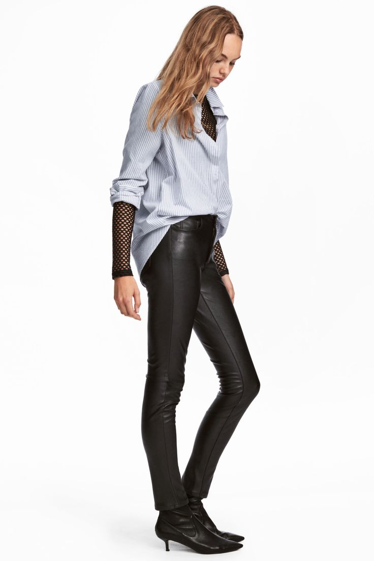 5-pocket trousers in stretch imitation leather with a regular waist, zip fly and button, and slim legs.