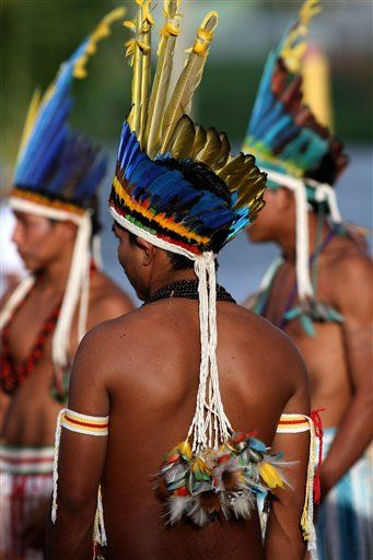 BRAZIL - Members of the Paresi ethnic group wait to perform a ritual dance during the Indigenous Games on the Island of Porto Real in the city of Porto Nacional, State of Tocantins. © Eraldo Peres for AP.