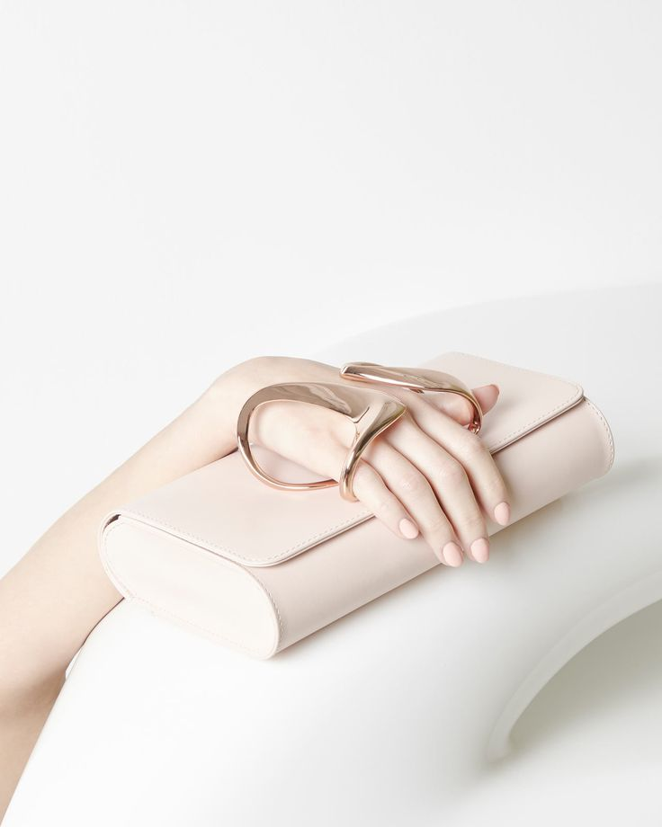 Perrin Paris releases a limited edition collection of leather clutches in collaboration with Zaha Hadid Design.