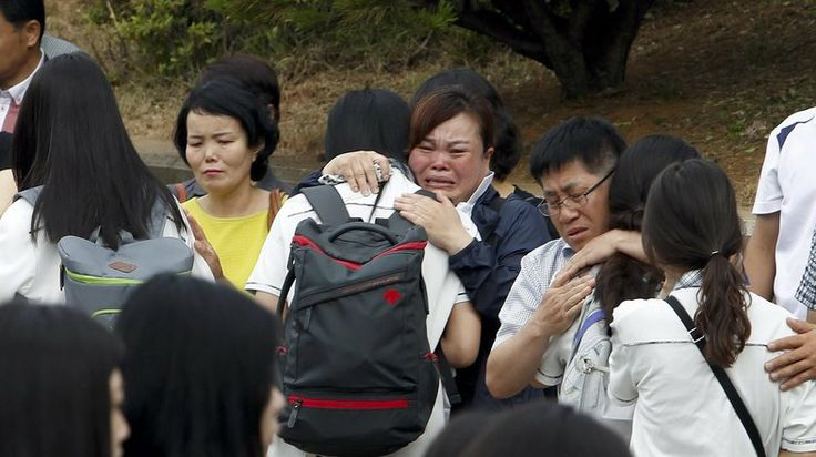 More than 70 second-year students who survived the sinking of the ferry Sewol returned to Danwon High School in Ansan, South Korea, on Wedne...