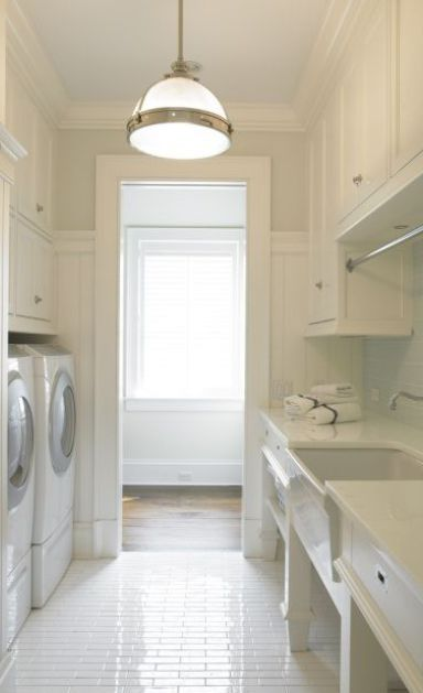 Clean Laundry Room with White Cabinets