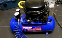 Silent Air Compressor - Homemade silent air compressor constructed by adding a refrigerator compressor and pressure switch to a commercial air compressor tank.