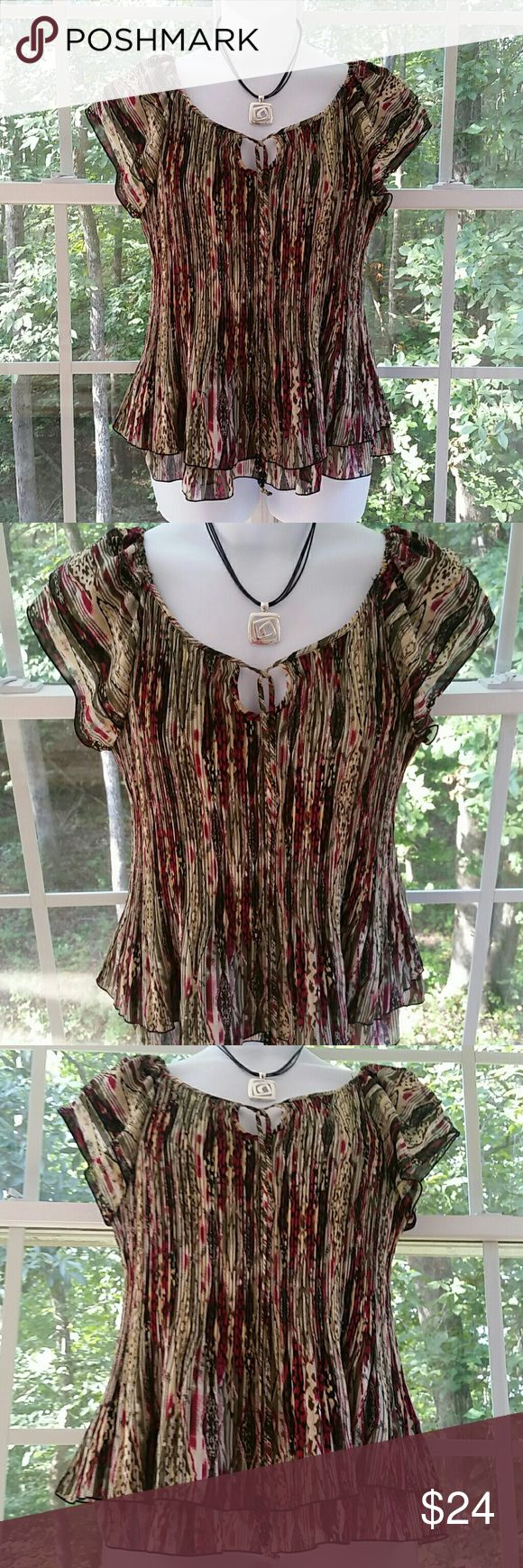 🆕ND New Directions Plus Size Tiered Top Super pretty multicolored tiered top from New Directions. Crinkle style. Keyhole opening in front with ties that have decorative beads on the ends. The tiered sleeves and bottom are gorgeous. Lining and shell 100% Polyester. Excellent condition, no issues. Don't miss out on this lovely top! Xoxoxoxo new directions Tops Blouses