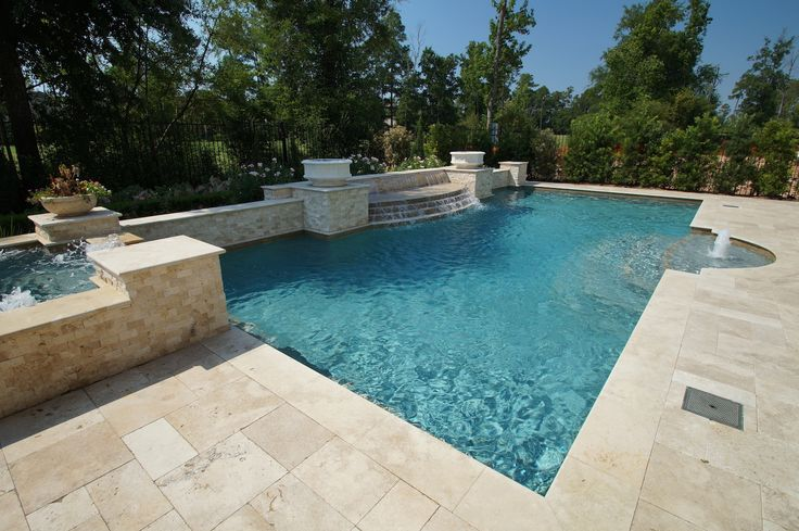 Formal pool with travertine deck & coping. Raised spa. Water feature, sheer descent and Blue Lagoon Wet Edge.