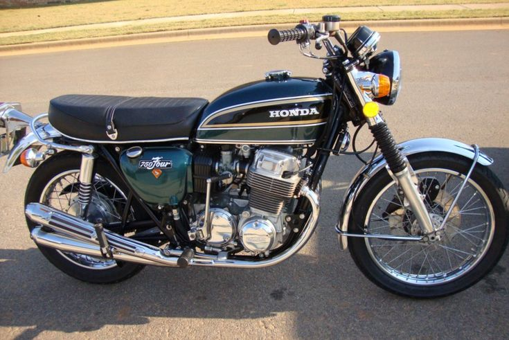 Owned a '74 Honda 750 K4 just like this to replace my Kawasaki H1 Mach III tripple. Picked it up new from the dealer and drove it home in the rain. Later added a 4 into 1 Kerker exhaust, better tires, a cafe seat, and lower bars and it became a good performing commuter bike that kept me happy.