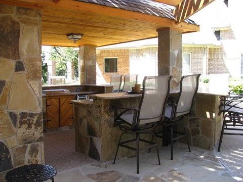 Outdoor flagstone kitchen under deck under deck for Outdoor kitchen under deck