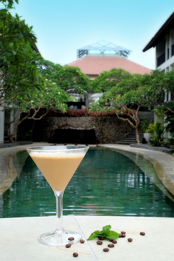 A refreshing Jamaican coffee cocktail and an inviting lagoon pool. What more could you ask for?!   #TheCamakilaLegianBali #camakilabali #camakila #legian #bali
