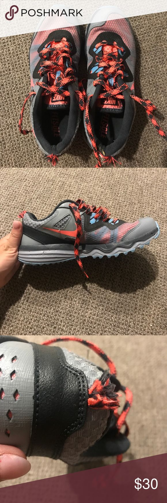 Nike Dual Fusion Running Shoes Light blue, pink and grey running sneakers by Nike. Only worn a couple times and in perfect condition for running. My dog did think it would be funny to chew off the some fabric at the back (see last two pics). Price reflecting condition. Trends are barely worn, but there are some esthetic issues by the heel as mentioned. Just don't fit me right. Nike Shoes Athletic Shoes