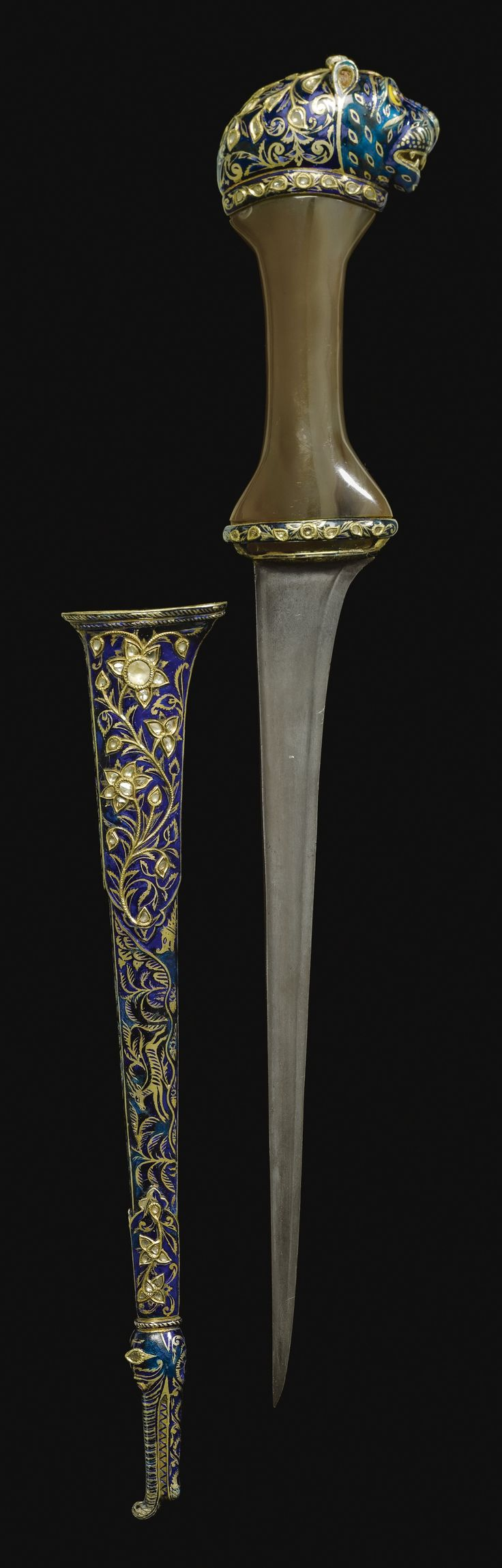 A richly enameled dagger c1790, Seringapatam, India. Possibly from the personal armoury of Tipu Sultan. Scabered enameled in blue with gold and white Bubri decoration. Hilt is a carved piece of agate. Pommel is enameled metal shaped like a tiger head.