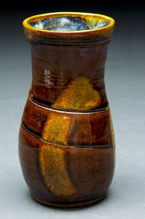 Lovely light brown vase with a golden yellow swipe. Red Stoneware reduction fired to cone 10  Available for purchase