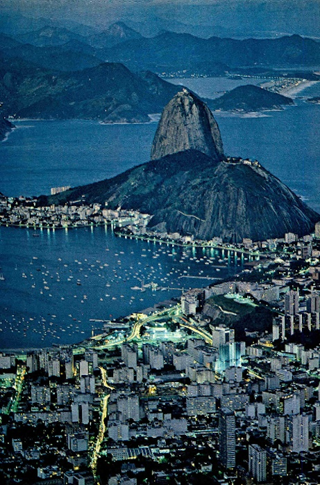 Nicholas DeVore III, the lights of the city dance about Sugar Loaf. From romantic Rio to industrious São Paulo and beyond, coastal Brazil knows no pause. National Geographic, February 1978