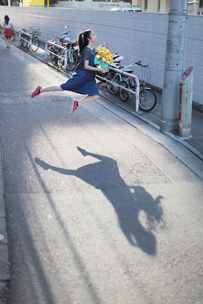"Japanese photographer Natsumi Hayashi glides through Tokyo without ever really touching her feet to the ground in her levitation photographs. Getting the right shot involves many attempts, and Hayashi says she either works with a friend or by herself through this following process: ""First, I get a composition and a focus manually. Then I press the shutter release, run to the right position for a levitation...and jump by my intuition. Incredible timing and composition of scenes. How creative!"