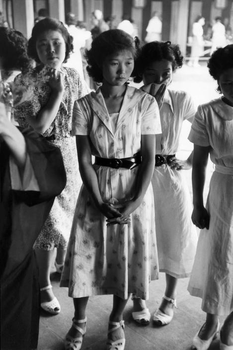 Students and young office girls during an Ikebana lesson, 1951 by Werner Bischof