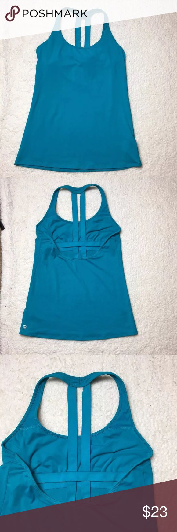 Real blue fabletics strappy back workout tank top Excellent pre owned condition fabletics blue strap back workout top with no flaws. Measurements taken while laid flat. Armpit to armpit 15 inches, length 25.5 inches. Fabletics Tops Tank Tops