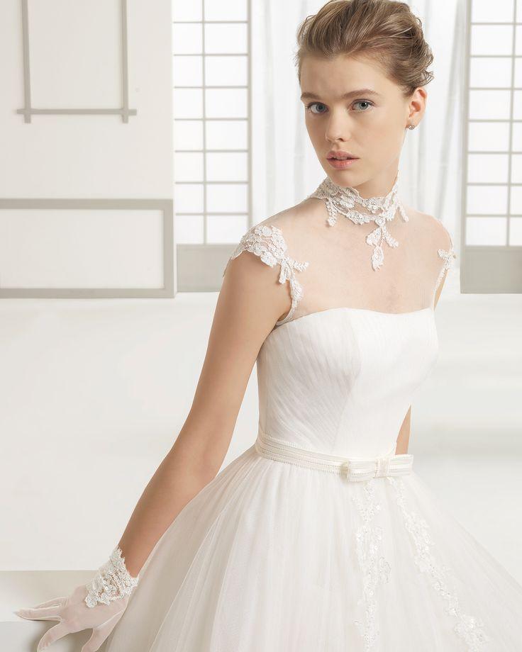 DANNA traje de novia en tul con aplicaciones de encaje pedrería.