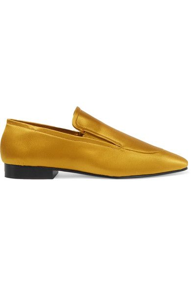 """""""Turn the color dial up to 11 this season, only the brightest and boldest hues will do,"""" says The EDIT. Joseph's menswear-inspired loafers have been made in Italy from eye-catching marigold satin. This cool pair has a sleek almond toe and elasticated inserts for a flexible fit. We like how they stand out against simple black outfits."""