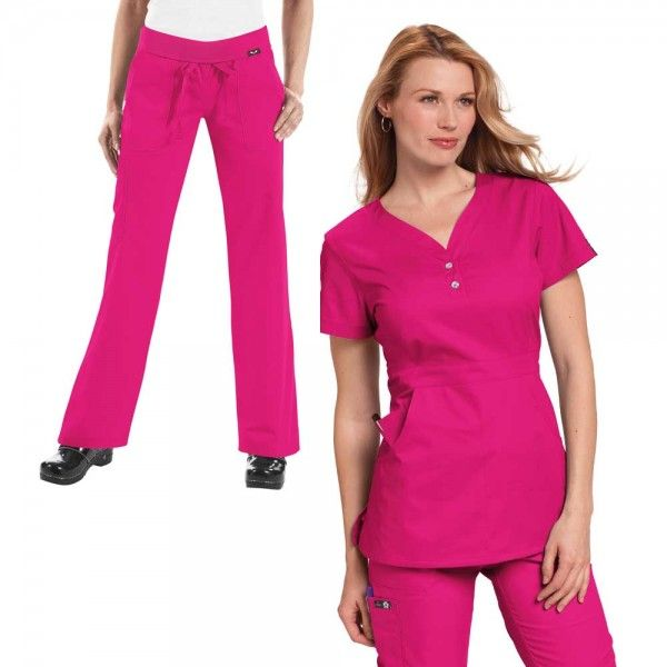 Koi Justine Set in Flamingo. The koi Justine top is super soft and has a synched back making it very flattering on all body shapes. And the Koi Scrubs Morgan Trousers feature an elastic waistband and drawstring closure for excellent comfort. £55 #nursescrubs #dentistscrubs #nurses #dentists #pinkscrubs #nurseuniform