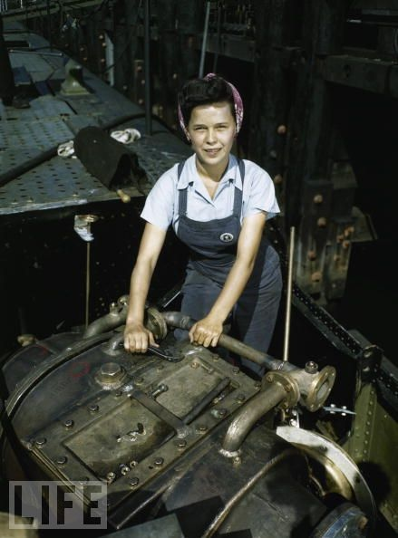 Portrait of an unidentified woman at work at the Electric Boat Company, Groton, Connecticut, October 1943. Later known as General Dynamics Electric Boat, the company produced more than 70 submarines and almost 400 PT boats during World War II. (Photo by Bernard Hoffman/Time & Life Pictures/Getty Images)