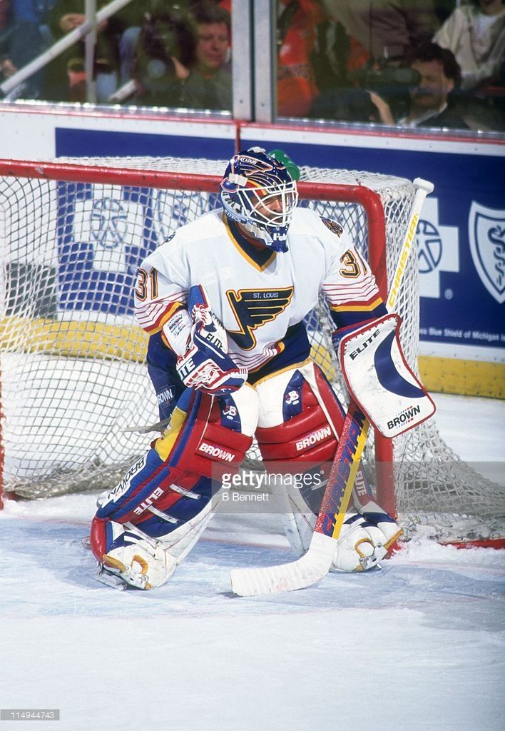 goalie-grant-fuhr-of-the-st-louis-blues-defends-the-net-during-an-nhl-picture-id114944743 (708×1024)
