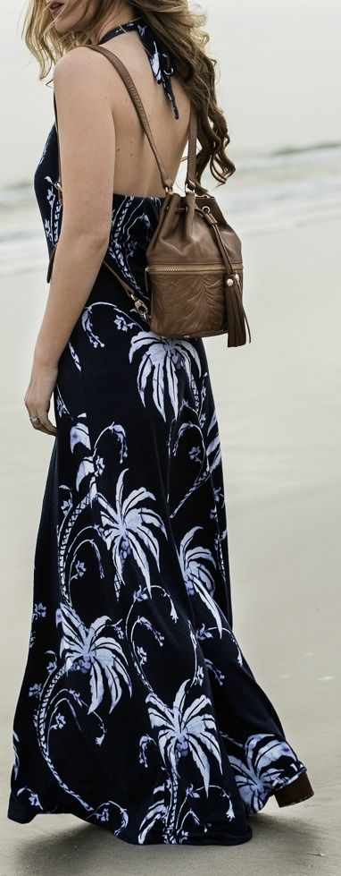 Cute vacation outfit styled with tropical print maxi dress and leather backpack