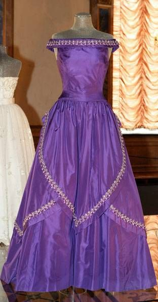 from http://nobelprize.org  Queen Silvia of Sweden 1985   Creation by Jørgen Bender, Copenhagen, this evening gown of violet silk tafetta is trimmed with crystals and glass beads on overlapping panels in the skirt and at the neckline.