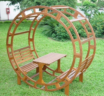 At first this rounded gazebo with benches and a table looks a bit strange, but I think it would very cool with climbing vines growing on it. Put a couple in a row and have an outdoor party.