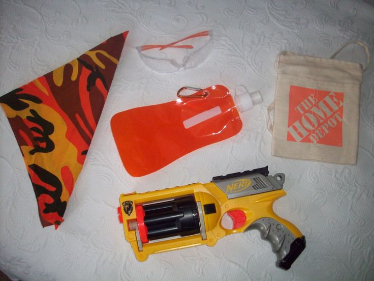 Nerf party goodie bags - Maverick Nerf gun (ToysRUs during 40% off Nerf sale), orange safety glasses (Amazon), orange camo bandana (Amazon), orange clip-on water bottle (GearXS.com), nail belt (Home Depot) to hold darts