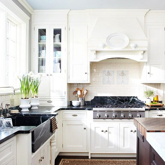 Great contrast of counters and cabinets. Also LOVE backsplash treatment of stove.