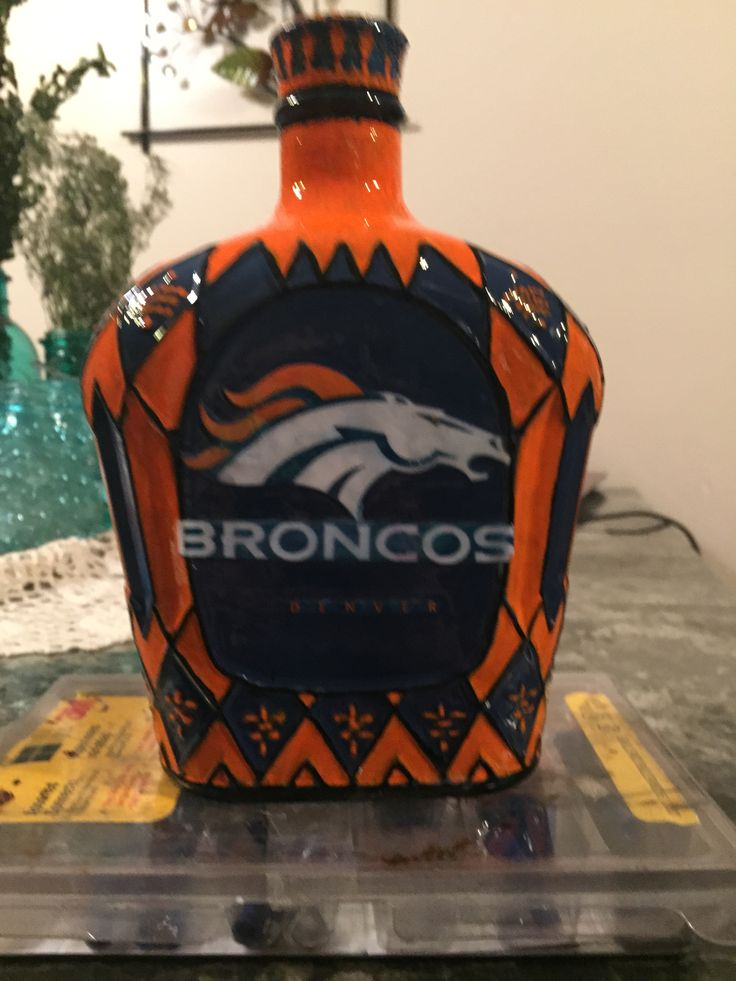 Broncos Crown Royal bottle. Spray painted, hand outlined, and decoupage image!!!