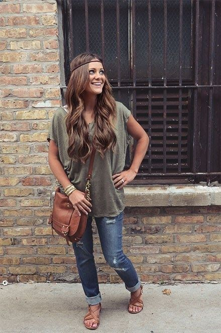 Street Style hunter green loose blouse with casual stylish jeans and brown leather hand bag and brown pumps