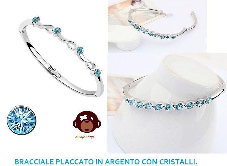 bracciale con cristallo simil swarovski azzurro,placcato in argento,bangle.nuovo