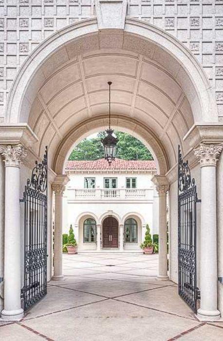 Mediterranean villa in Atlanta, Georgia - pic 2 of 3 - View through Gated Porte-Cochere into Entry Motor Court
