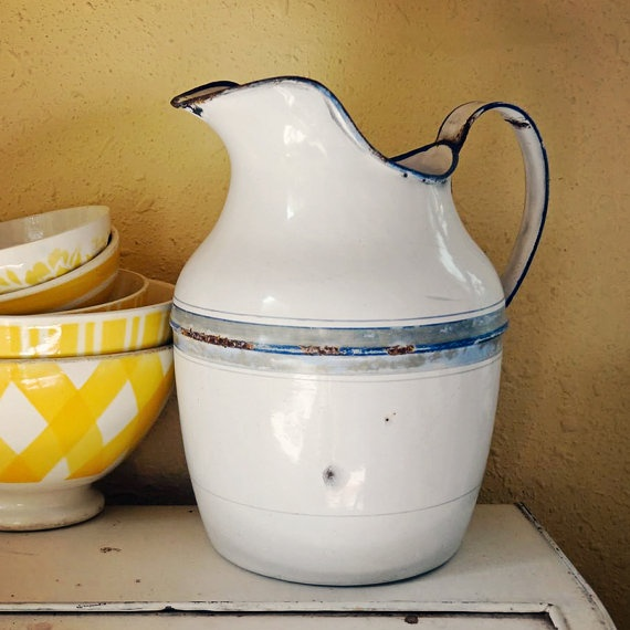 vintage French enamel pitcher with lovely curved shape. Available at AtticAntics on Etsy