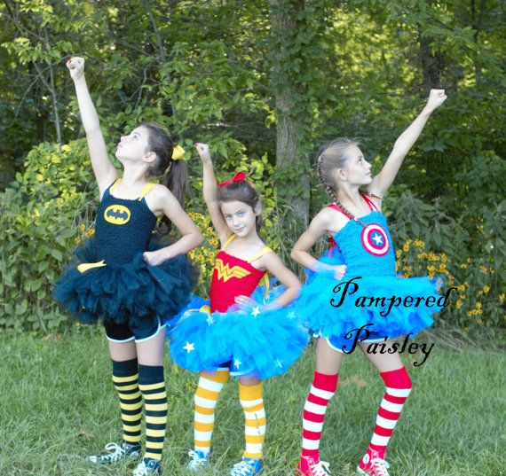 This listing is for your choice of one of the super hero tutu outfits. Batgirl, Wonder Woman, or Captain America! These costumes are all hand crafted. Batgirl comes with the tutu dress, a ribbon attached to the dress, and a mask. Wonder Woman includes the tutu dress, a ribbon tied to the tutu, and a flower headband. Captain America includes the tutu dress, a sash for around the waist and mask. This beautiful baby Petti Tutu Dress is custom designed and hand made with super soft quality tu...