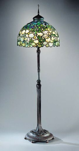 A 'SNOWBALL' LEADED GLASS AND BRONZE FLOOR LAMP   Tiffany Studios, circa 1910   76½in. (194.3cm.) high, 24½in. (62.2cm.) diameter of the shade, with 'pigtail' finial  the shade tag stamped TIFFANY STUDIOS NEW YORK, the base stamped TIFFANY STUDIOS NEW YORK 21551 with the Tiffany Glass & Decorating Co. monogram